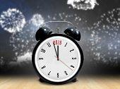 2015 in black alarm clock against wooden planks