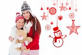 Mother and daughter with teddy against hanging red christmas decorations