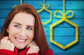 Happy redhead against blurred christmas background