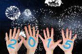 Hands against white fireworks exploding on black background