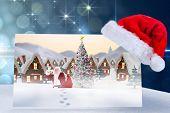 Santa delivery presents to village against light design on blue background