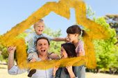 House outline in clouds against parents giving children a piggyback