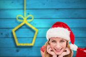 Smiling woman lying between sale shopping bags against blurred christmas background