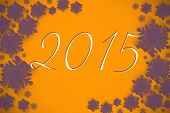 2015 against purple snowflake design on orange
