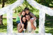Parents giving children a piggyback against house outline in clouds