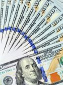 stock photo of ten thousand dollars  - fan of 100 dollar bills closeup - JPG