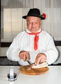 Man Wearing Traditional At The Table