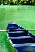 Blue Boat On Green Tropical Water