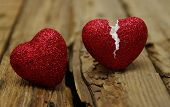 Broken heart on wood background