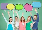 school, education, communication, gesture and people concept - group of smiling teenagers waving hands over green board background with text bubbles