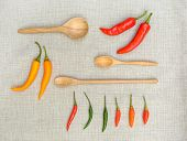 Fresh Chili With Wooden Spoon On Sackcloth
