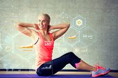 fitness, sport, training, future technology and lifestyle concept - smiling woman doing exercises on mat in gym over graph projection