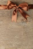 Old wooden background with beautiful bow