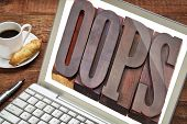 internet concept - oops exclamation word in vintage wooden letterpress printing blocks on laptop screen