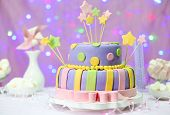 Delicious birthday cake on shiny pink background