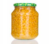 Glass jar with canned corn.