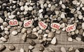 Pebble stones with german text for luck, force, fun, love and power. Concept for harmony and balance.