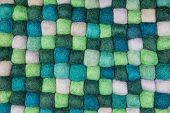 Handmade background of felt in green for creative items.