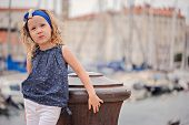cute child girl on the walk in marina in piran, slovenia