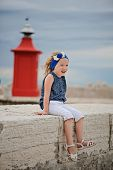 cute child girl with red lighthouse