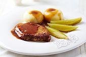 Roast pork chop with sauce and potato dumplings (Poland)