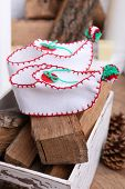 Firewood with Christmas shoes on wooden floor background