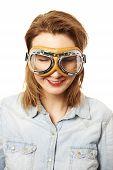 Girl in aviator glasses over white
