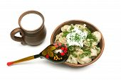 Dumplings With Fresh Herbs And Sour Cream In A Clay Plate And Cup With Milk On White Background