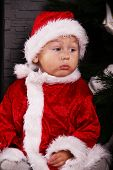 funny baby dressed as Santa Claus