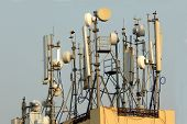 Mobile phone antenna dishes. Wireless communication