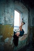 Brunette With Big Boobs In Short Dress Lying With Their Legs In The Window Of An Old Building