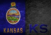 picture of kansas  - Old rusty metal sign with a flag and US state abbreviation  - JPG
