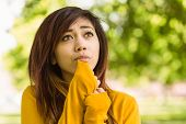 Close up of beautiful young woman looking away in park