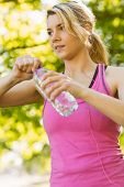 Fit blonde holding her water bottle on a sunny day