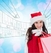 Cheerful brunette in winter wear holding shopping bags against twinkling yellow and purple lights