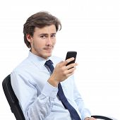 Young Businessman Sitting On A Chair Using A Smart Phone