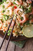 Fried Rice With Shrimp And Vegetables And Chopsticks. Vertical