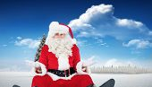 Doubtful santa sitting alone against fir tree in snowy landscape