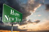 Happy new year against blue and orange sky with clouds