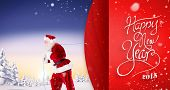 Composite image of santa claus pulling rope against red vignette