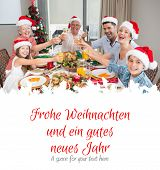 Family in santas hats toasting wine glasses at dining table against christmas greeting in german