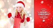 happy festive blonde with shopping bag against red vignette