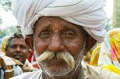 Closeup Of An Older Rajasthan's Man Face With Turban.