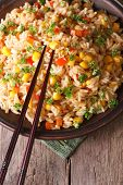 Fried Rice With Eggs, Corn And Spices And Chopsticks