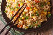 Asian Fried Rice With Corn And Eggs Close-up Horizontal Top View