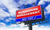 Warehouse Management on Red Billboard.