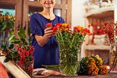 Female florist selling fresh flowers