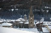 French Alps In Winter: The Ancient Belfry In A  Little Mountain Village