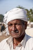 Cattle Farmer With Scarf Around His Head.