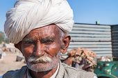 Stern Old Cattle Farmer With White Turban.